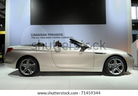 TORONTO-FEBRUARY 17: BMW 650i Cabriolet with its breathtaking silhouette at the 2011 Canadian International Auto Show on February 17, 2011 in Toronto - stock photo
