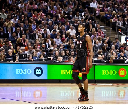 TORONTO - FEBRUARY 16: Chris Bosh #1 participates in an NBA basketball game at the Air Canada Centre on February 16, 2011 in Toronto, Canada.  The Miami Heat beat the Toronto Raptors 103-95. - stock photo