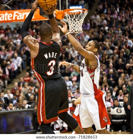 TORONTO - FEBRUARY 16: Dwyane Wade No. 3 participates in an NBA basketball game at the Air Canada Centre on February 16, 2011 in Toronto, Canada.  The Miami Heat beat the Toronto Raptors 103-95. - stock photo