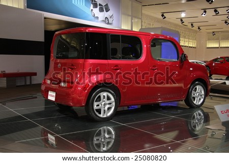 TORONTO, FEBRUARY 11: Nissan Cube on display at the Canadian International AutoShow 2009.  More than 1000 cars are trucks are on display at this show - stock photo