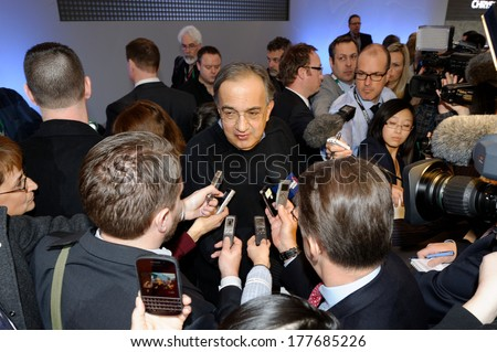 TORONTO-FEBRUARY 14: Sergio Marchionne, CEO of FIAT/Chrysler, answers journalists' questions  the 2014 Canadian International Auto Show on February 14, 2014 in Toronto           - stock photo