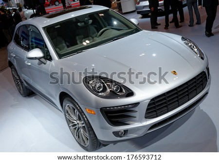 TORONTO-FEBRUARY 14: The all New 2015 Porsche Macan is the first compact SUV Porsche at the 2014 Canadian International Auto Show on February 14, 2014 in Toronto           - stock photo