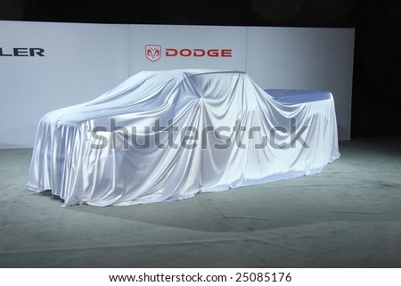 TORONTO, FEBRUARY 11: waiting to be unveiled Dodge Ram Heavy Duty Chassis Cab pick-up truck at the Canadian International AutoShow 2009 - stock photo