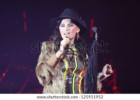 TORONTO - JANUARY 24:  Nelly Furtado performs at the Sony Centre for Performing Arts, on January 24th, 2013 in Toronto. - stock photo