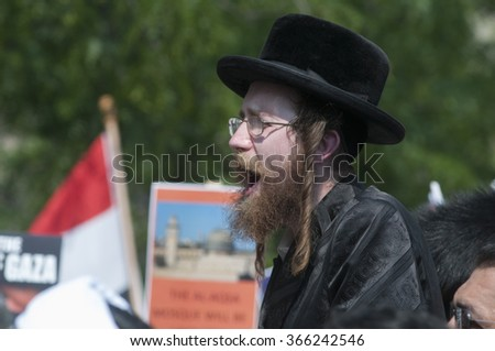 TORONTO-JULY 11: A Jewish rabbi speaking during the Al-Quds day rally on July 11, 2015 in Toronto,Canada. - stock photo