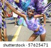 TORONTO - JULY 17: A participant dancing during the Junior Caribana Parade on July 17, 2010 in Toronto. - stock photo