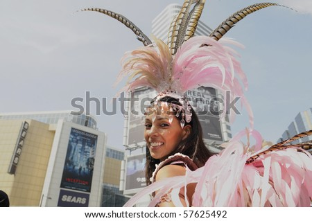 TORONTO - JULY 15: A participant during the official launch of 2010 Annual Caribana Festival at Yonge & Dundas square on  July 15, 2010 in Toronto. - stock photo