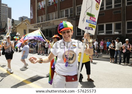 TORONTO - JULY 3: A participant holding a placard during the Dyke March on July 3, 2010 in Toronto.