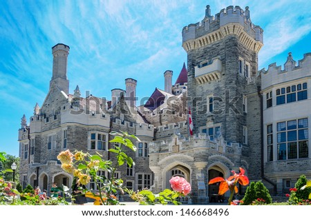 TORONTO-JULY 13: Casa Loma is one of Toronto's top ten tourist attractions. Around 300,000 visitors tour Casa Loma and the Estate Gardens each year. As seen on July 13, 2013 in Toronto, Canada - stock photo