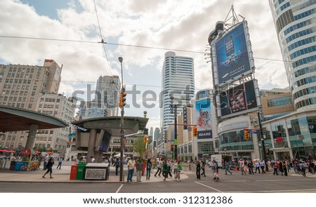TORONTO - JULY 12, 2008: City buildings on a summer day. Toronto attracts 10 million visitors annually.
