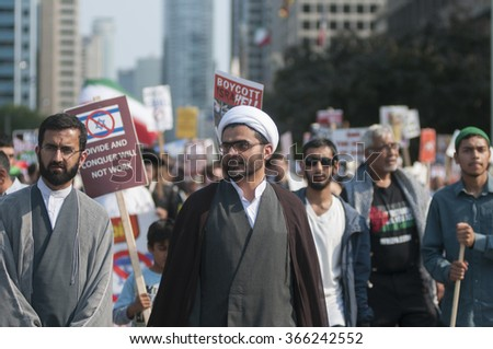 TORONTO-JULY 11: Iranian religious leaders marching during the Al-Quds day rally on July 11, 2015 in Toronto,Canada. - stock photo