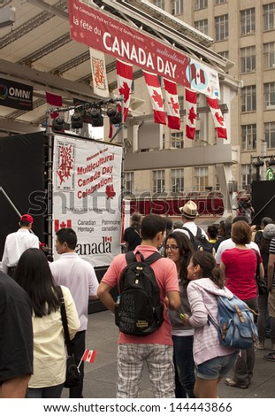 TORONTO - JULY 1, People gathered for Multicultural Canada Day Celebration at Yonge Dundas square   July 1, 2013 in Toronto, Canada. - stock photo