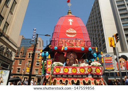 TORONTO - JULY 13: The chariot passing Yonge street in Toronto  during the 41st Annual Festival of India on July 13, 2013 in Toronto-Canada. - stock photo
