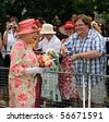 TORONTO-JULY 06: The crowds waited patiently for hours for a sighting of the 84-year-old monarch and the Duke of Edinburgh in Toronto, July 06, 2010 - stock photo