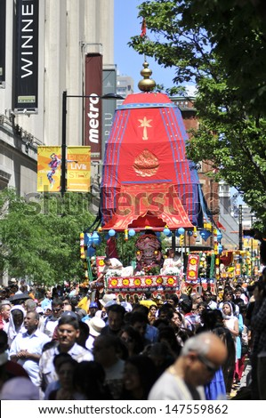 TORONTO - JULY 13:  The holy chariot rolling down the Yonge  street during the 41st Annual Festival of India on July 13, 2013 in Toronto-Canada. - stock photo