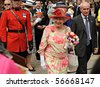 TORONTO-JULY 06: The Queen, dressed in a bright pink hat with a light green ribbon and a matching patterned dress, smiled and chatted with many in the crowd in Toronto, July 06, 2010 - stock photo