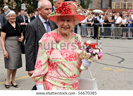 TORONTO-JULY 06: Thousands of people packed University Avenue and the grounds of Queen's Park to catch a glimpse of the Queen and the Duke of Edinburgh in Toronto, July 06, 2010 - stock photo