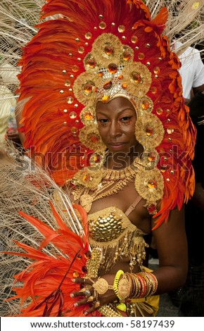 TORONTO - JULY 31: Woman in costume in the Caribana 2010 Parade, a cultural explosion of Caribbean music, cuisine and performing arts on July 31, 2010 In Toronto. - stock photo