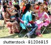 TORONTO – JULY 17:  Women painting face at 39th Annual festival of India in July 17 2011 on Central Island in Toronto, Canada. The festival is a popular annual  attraction  for the last 39 years. - stock photo