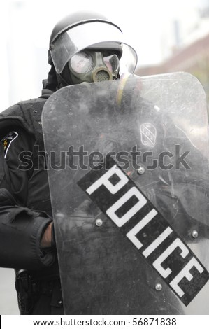 TORONTO-JUNE 26:  A Toronto Riot Police officer wearing gas mask  during the G20 Protest on June 26, 2010 in Toronto, Canada.