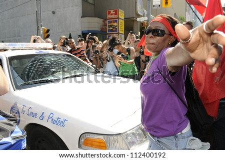 TORONTO-JUNE 25:  An angry protesters stopping a police vehicle  during the G20 Protest on June 25, 2010 in Toronto, Canada. - stock photo