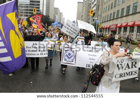 TORONTO-JUNE 26:Anti -Israel activists protesting against war crime  during the G20 Protest on June 26 2010 in Toronto, Canada.