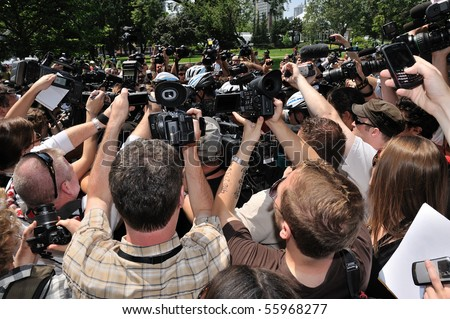 TORONTO-JUNE 25:Large group of reporters taking pictures and video recording of police and protesters confrontation at G20 Protest on June 25, 2010 in Toronto, Canada. - stock photo