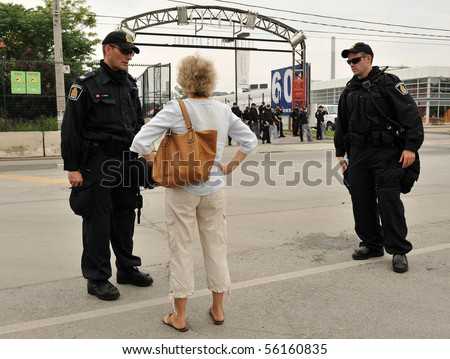 TORONTO-JUNE 27: Parent of young detained protester pleads with police in front of Toronto Film Studios at G20 protest on June 27, 2010 in Toronto. - stock photo