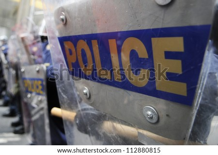 TORONTO-JUNE 26:   Police  officers blocking  protesters with their riot shield during the G20 Protest on June 26, 2010 in Toronto, Canada.