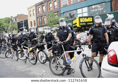 TORONTO-JUNE 26:   Police officers on bicycle protecting the shopping district on the queen street  during the G20 Protest on June 26 2010 in Toronto, Canada.