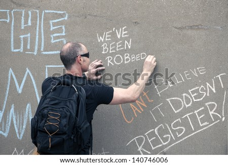 TORONTO - JUNE 1 :Protester writing slogan against Mayor Rob Ford   June 1, 2013   in Toronto, Canada. - stock photo