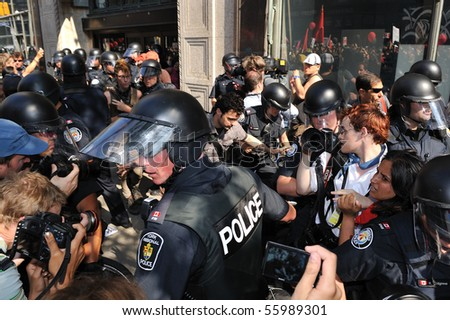 TORONTO-JUNE 25: Protesters and police confrontation at G20 Protest on June 25, 2010 in Toronto, Canada. - stock photo