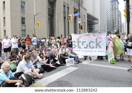TORONTO-JUNE 27:  Protesters and victims of the mass arrest a before on the hand during the G20 Protest on June 27, 2010 in Toronto, Canada. - stock photo