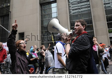 TORONTO-JUNE 26:  Protesters chanting slogans on a microphone in downtown  during the G20 Protest on June 26 2010 in Toronto, Canada. - stock photo
