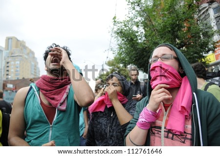 TORONTO-JUNE 26:   Protesters wearing masks to hide their faces  while chanting slogans during the G20 Protest on June 26 2010 in Toronto, Canada. - stock photo