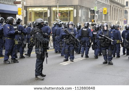 TORONTO-JUNE 26:   Riot police controlling the streets and getting ready for any type of problem  during the G20 Protest on June 26, 2010 in Toronto, Canada.
