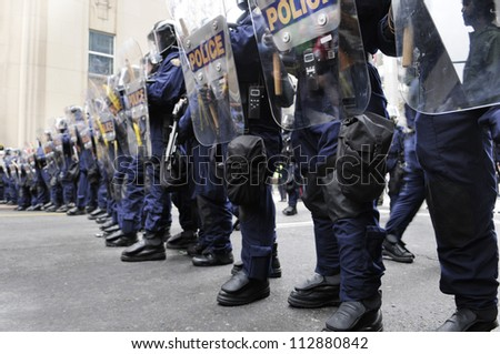 TORONTO-JUNE 26:  Riot police officers forming a barricade during the G20 Protest on June 26, 2010 in Toronto, Canada.