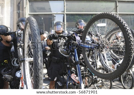 TORONTO-JUNE 25:  Toronto Cycle Police in riot gears creating a perimeter  after an  arrest during the G20 Protest on June 25, 2010 in Toronto, Canada. - stock photo