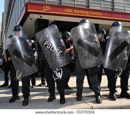TORONTO-JUNE 25: Toronto Riot Police in front of the CIBC Bank Centre on June 25, 2010 in Toronto, Canada. - stock photo