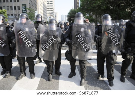 TORONTO-JUNE 25:  Toronto Riot Police  restricting  the protesters from entering the  actual G20 summit  perimeter on University Avenue during the G20 Protest on June 25, 2010 in Toronto, Canada. - stock photo