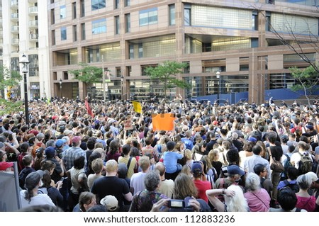 TORONTO-JUNE 28:  Torontonians  gather outside the police headquarters  to protest against the mass arrest a day before during the G20 Protest on June 28, 2010 in Toronto, Canada. - stock photo
