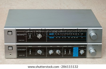 Toronto - June 10: Vintage home audio system Sanyo two-band (AM and FM) tuner and amplifier photographed on June 10, 2015 - stock photo
