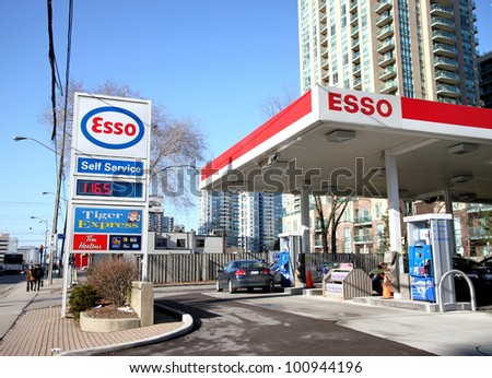 TORONTO - MARCH 16: A Esso gas station on March 16, 2011 in Toronto. In Canada, the Esso brand is used on stations operated by Imperial Oil, which is 69.8% owned by ExxonMobil.