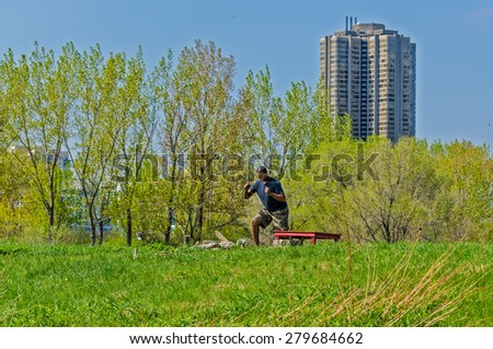 TORONTO - MAY 17: An unidentified young athlete works out in a Hunber Bay waterfront park in Toronto on May 17, 2015. - stock photo
