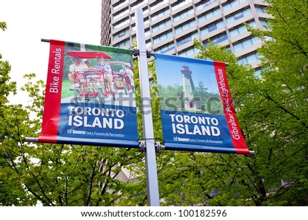 TORONTO - MAY 20: Toronto Island ads banners on May 20, 2011 in Toronto. The Toronto islands comprise the largest urban car-free community in North America. - stock photo