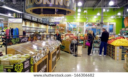 TORONTO - NOVEMBER 9: A Whole Foods supermarket on November 9, 2013 in Toronto. Whole Foods Market, Inc. is an American foods supermarket chain headquartered in Austin, Texas. - stock photo