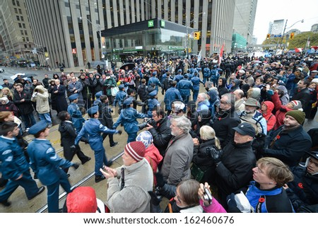 TORONTO - NOVEMBER 11: Military parade takes place during Remembrance Day Services at Old City Hall Cenotaph in Toronto on November 11, 2013.