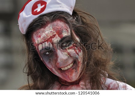TORONTO-OCTOBER 20: A participant dressed as a nurse during the Halloween parade on October 20, 2012 in Toronto, Canada. - stock photo