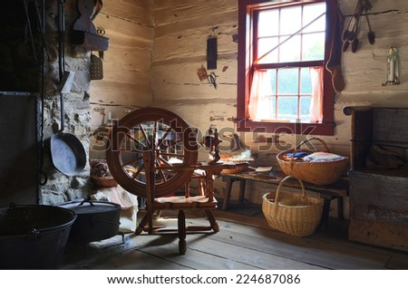 TORONTO OCTOBER 7: Interior of an old country house with antique spinning wheel in Black Pioneer Village, a living history museum in Toronto, Ontario, Canada in October 7, 2014. - stock photo