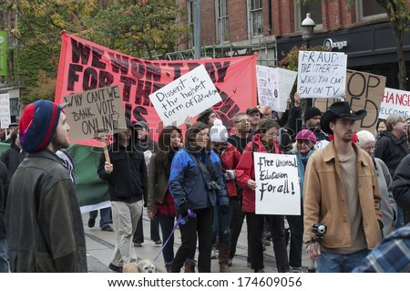 TORONTO, OCTOBER 22, 2011: Occupy Toronto is part of the Occupy movement, which protests against economic inequality, corporate greed, and the influence of corporations and lobbyists on government. - stock photo